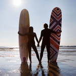 surfing-couple-handholding-400x400